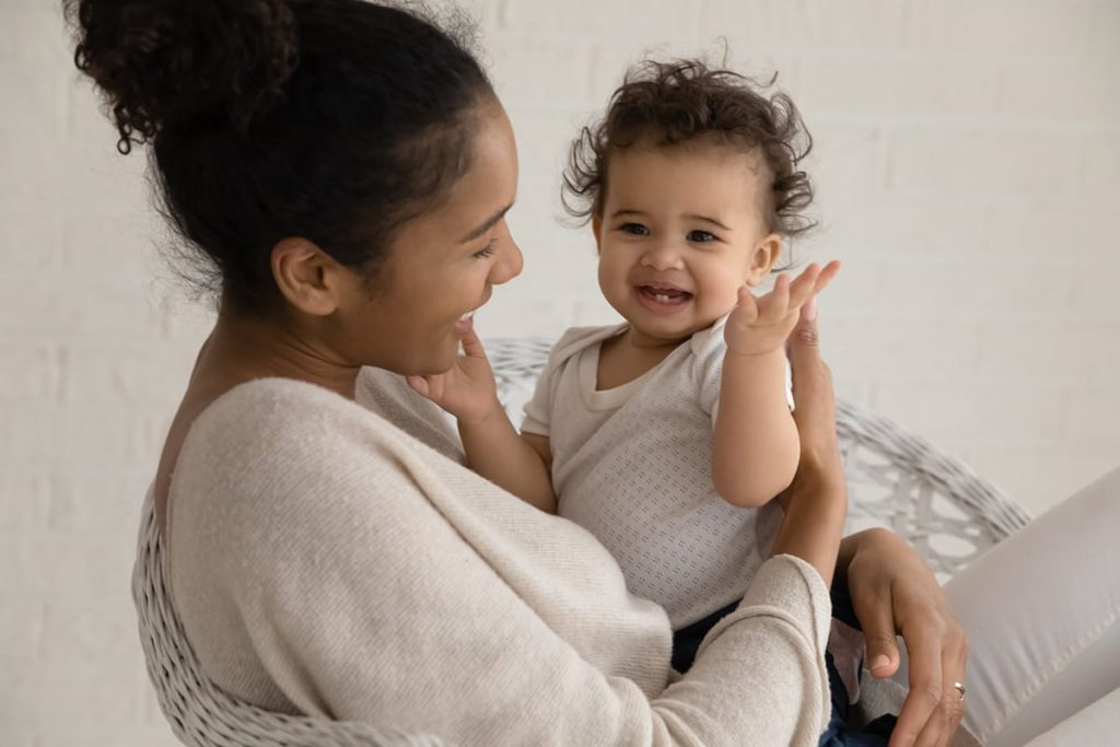 Young happy mother with a baby